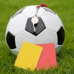 Referee whistle, red and yellow card and ball.